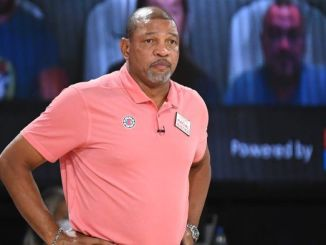 Doc Rivers stands sideline.