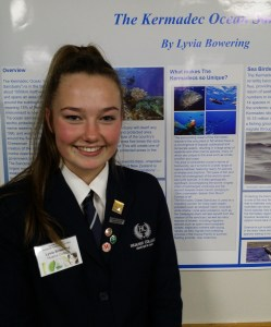 TOP TALENT: Huanui College Head Girl Lyvia Bowering in front of her exhibit on the Kermadec Ocean Sanctuary.