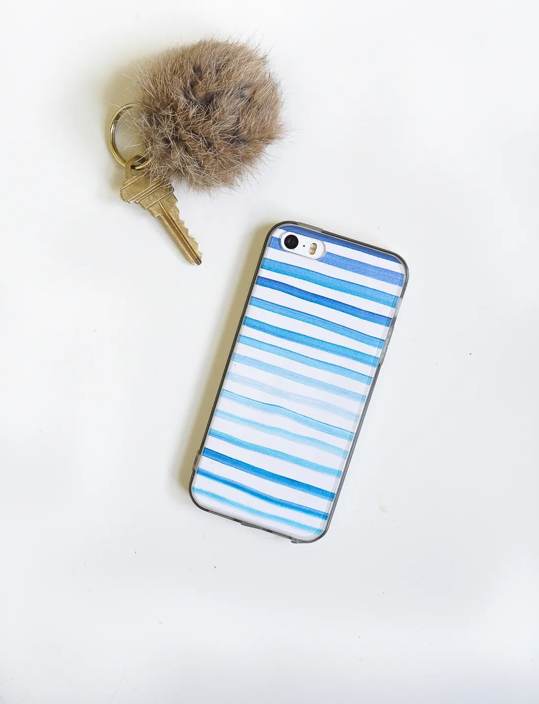 Make a DIY watercolor phone case in just about 5 minutes! Click for the deets!