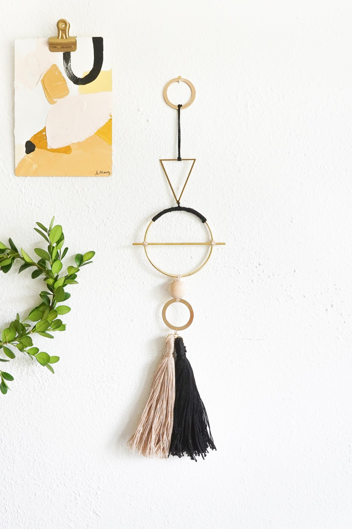Add interest to your gallery wall with a geometric metal wall hanging. Get the tutorial link here!