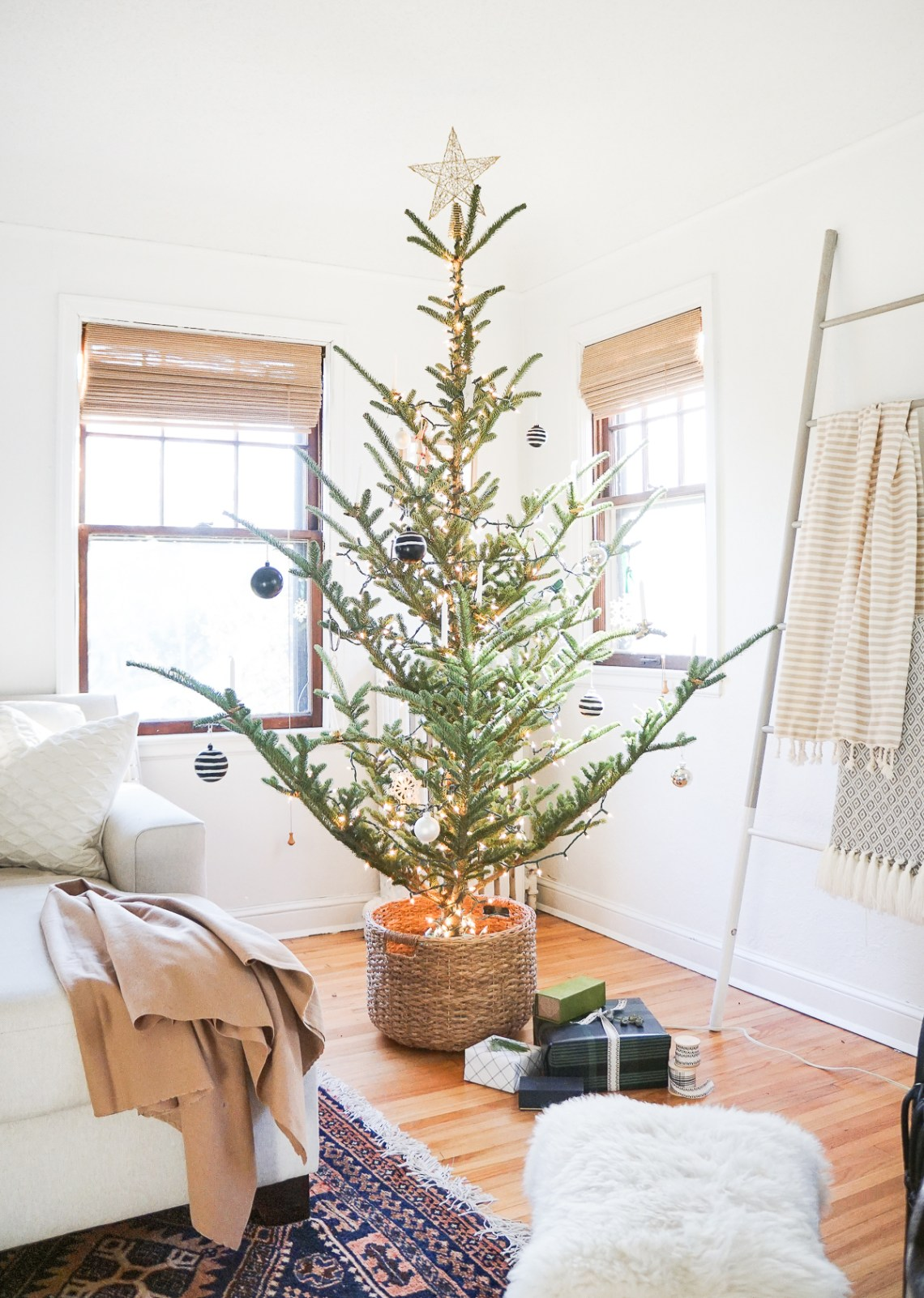 How to get the Christmas tree basket set-up in lieu of a tree skirt. Plus! Nordic-style tree inspiration!