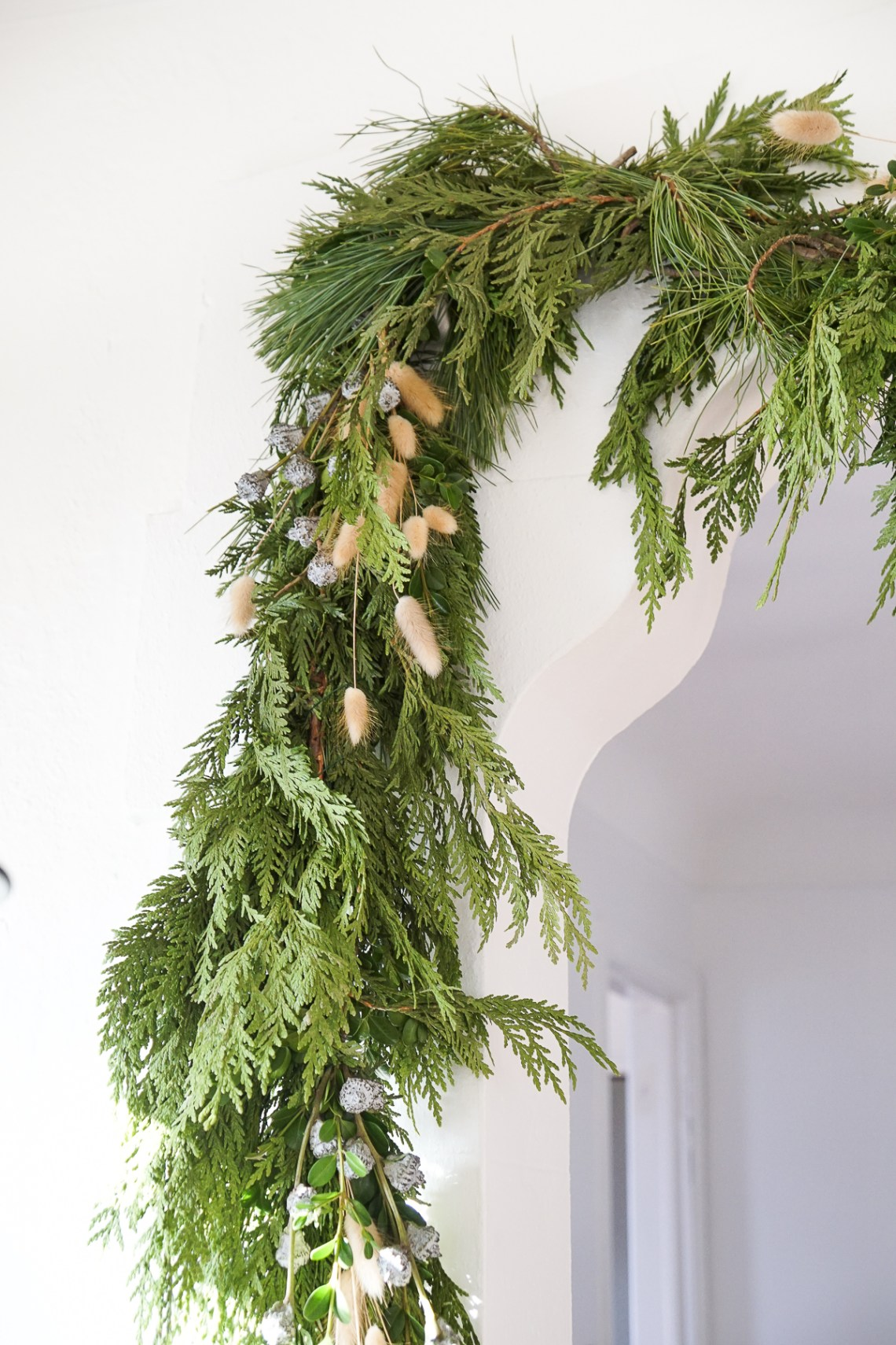 What I use to strongly, but temporarily hang garland in my house without damaging the walls.