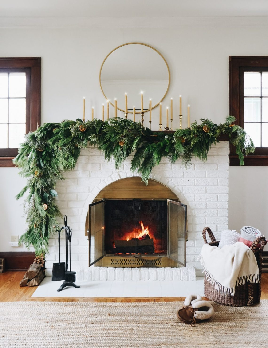Asymmetrical garland: an unexpected take on traditional Holiday fireplace mantel decor. Hear my thought process and how to create the look at your house.