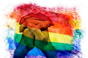 multiple exposures of the rainbow flag and the clasped hands of a man