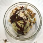 No Churn Avocado Ice Cream garnished fully with cake crumbs. pistachios, coconut, and chocolate ganache