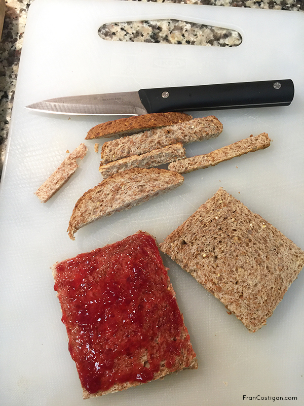 Cutting bread with jam for a Strawberry Cream Sando