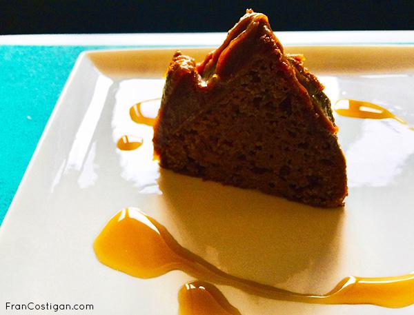 Bundt cake slice frosted with pumpkin butter