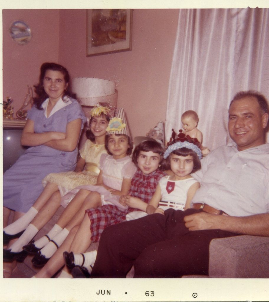 Gary, Indiana New Year 1963.  Why are they all smiling?  Because baby Francy is napping!  Mom, Nora, Jeanie, Toni, Zina, and Dad.