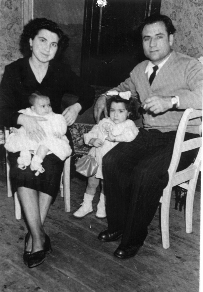 Mom holding baby Antonia and Dad holding Nora (Onofria) in Belgium, 1950's