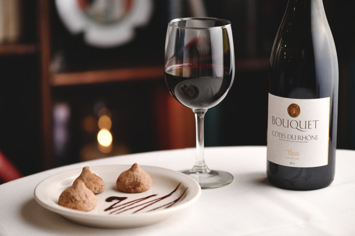 Chocolate truffles with a bottle of Cotes Du Rhone