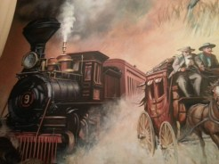 Mural at the Gene Autry Museum displaying the railroad and stage coach relationship in the Western Frontier. Photograph by Rosemary Irvine