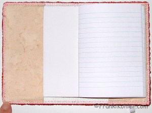 Notebook cover, paper, open