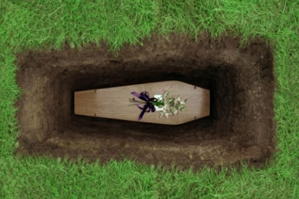 Coffin-in-grave.jpg