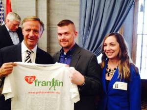 During the March announcement of Franklin & Get Fit Franklin as a pilot community for Gov. Bill Haslam's Healthier Tennessee Initiative, Get Fit Franklin Wellness Champions Michael & Christa Gonzales presented Gov. Haslam with his own Get Fit Franklin t-shirt.