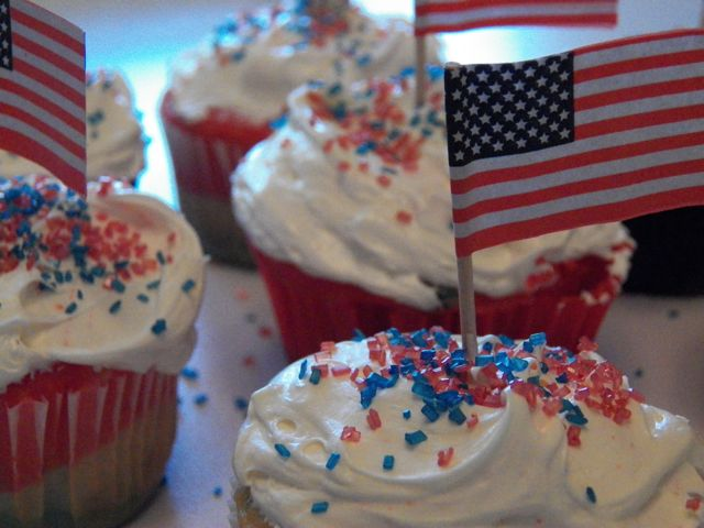 Red, White, and Blue Cupcakes with white topping and red and blue sprinkles