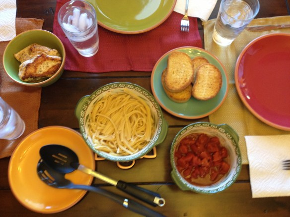 Grilled chicken, pasta, tomatoes and garlic bread