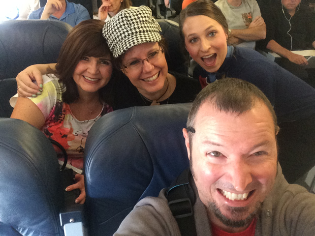 The Three Writing Amigos. . . and a Photobombing Flight Attendant