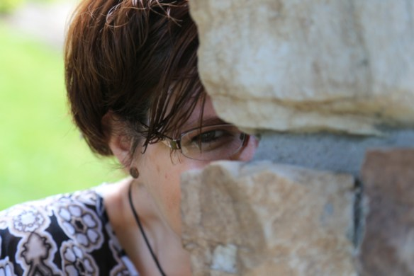 Molly Jo Realy playing peek-a-boo with a stone column at Blue Ridge.