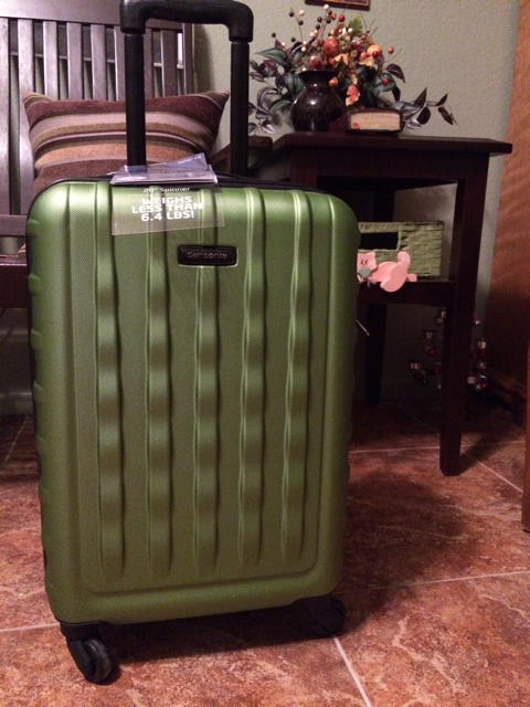 """Oh, the places you'll go!"" My new green suitcase."