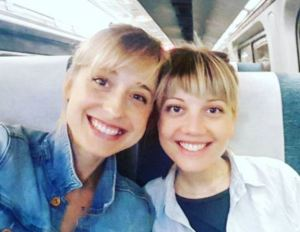 Allison Mack and Nicki Clyne, both members of DOS. They might be married.