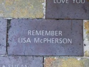 memorial brick says Remember Lisa McPherson