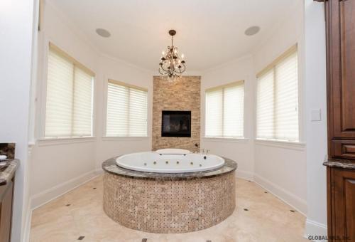 Sara Bronfman bathroom with circular tub