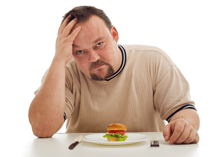 Man frustrated with tiny hamburger on plate misleading