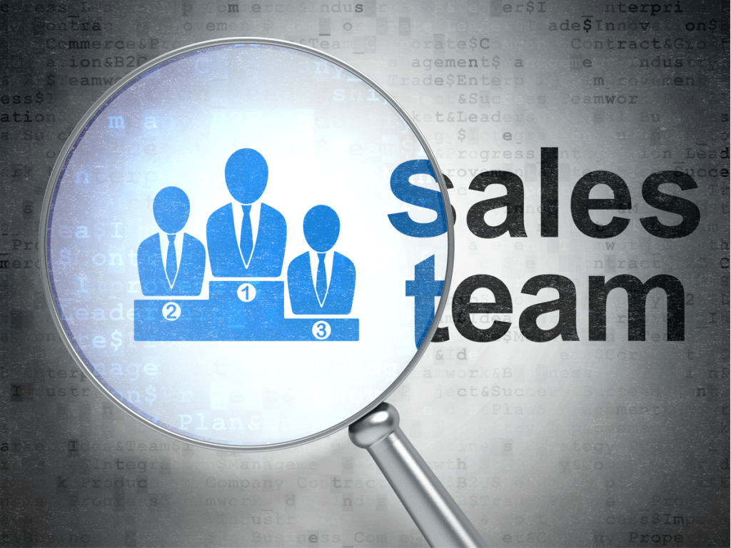 Magnifying glass over the words sales team