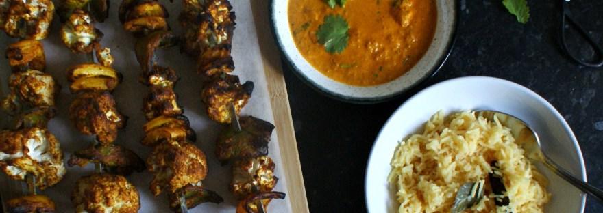 Skewers, makhani sauce and pilau rice