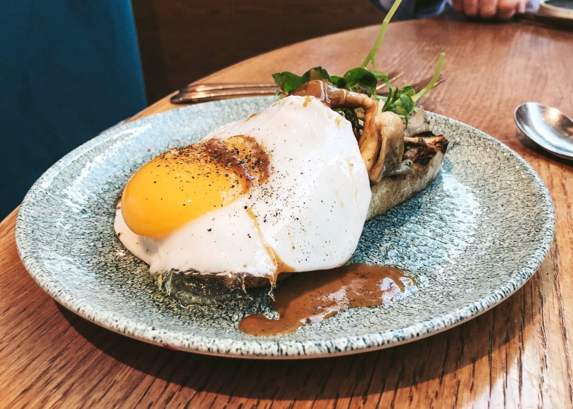 Wild mushrooms on toast with a fried duck egg