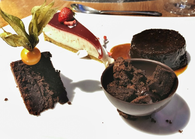Dessert platter: strawberry cheesecake, sticky toffee pudding, cherry chocolate sphere and chocolate brownie