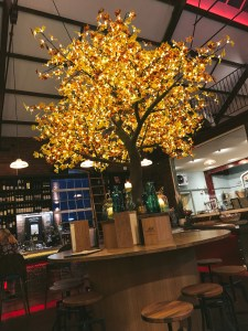 Copper trees are dotted about the restaurant, glittering with lights