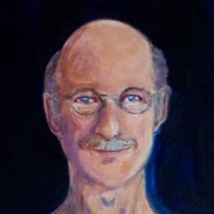 Detail of head from full-length portrait of one-armed artist. He is smiling, and is white, balding with some grey hair and wearing round wire-rimmed glasses