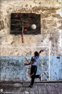 Playing basketball in a neglected sport hall in Armenia