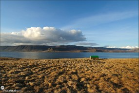 Little hut in the wide open scenery of Westfjords, Iceland
