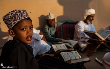 Scholar and his students reading Quran, Muscat, Oman