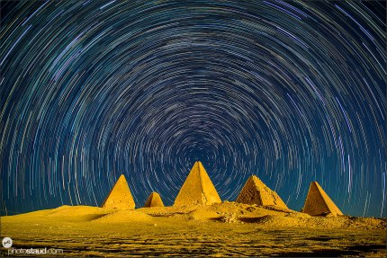 Jebel barkal pyramids under startrails of the northern sky, Sudan