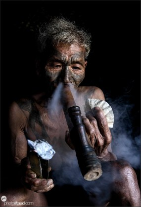 Old Konyak man smoking opium, Nagaland, India