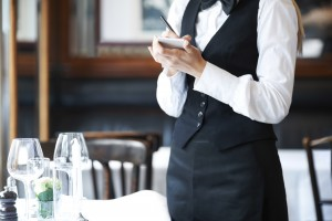 """Front-of-the-house"" employees are making plenty of money, but because their money comes primarily out of the customers' pockets via tips, it can't be redistributed to where it's needed: in the kitchen to retain staff. (photo:Yuri Arcurs/Getty Images)"