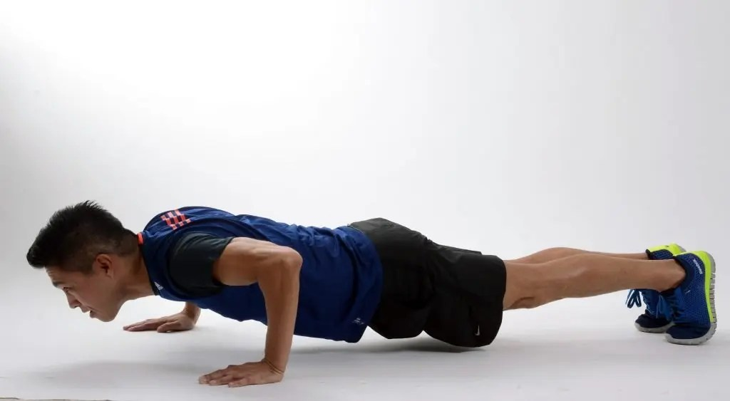 Man push-ups as he daily fitness goals and workout routine