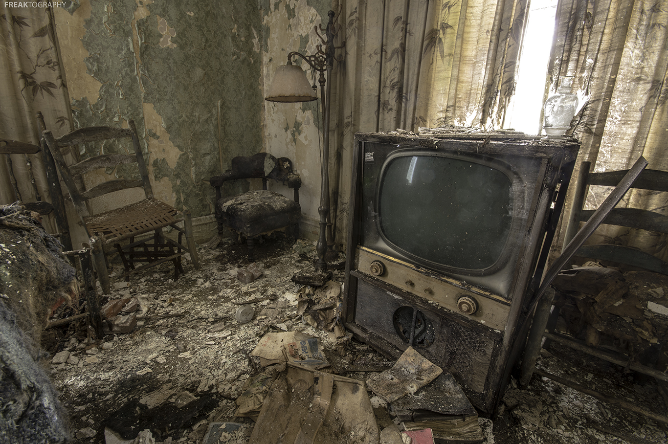 The destruction caused by time and elements inside an old abandoned farmhouse on Ontario.