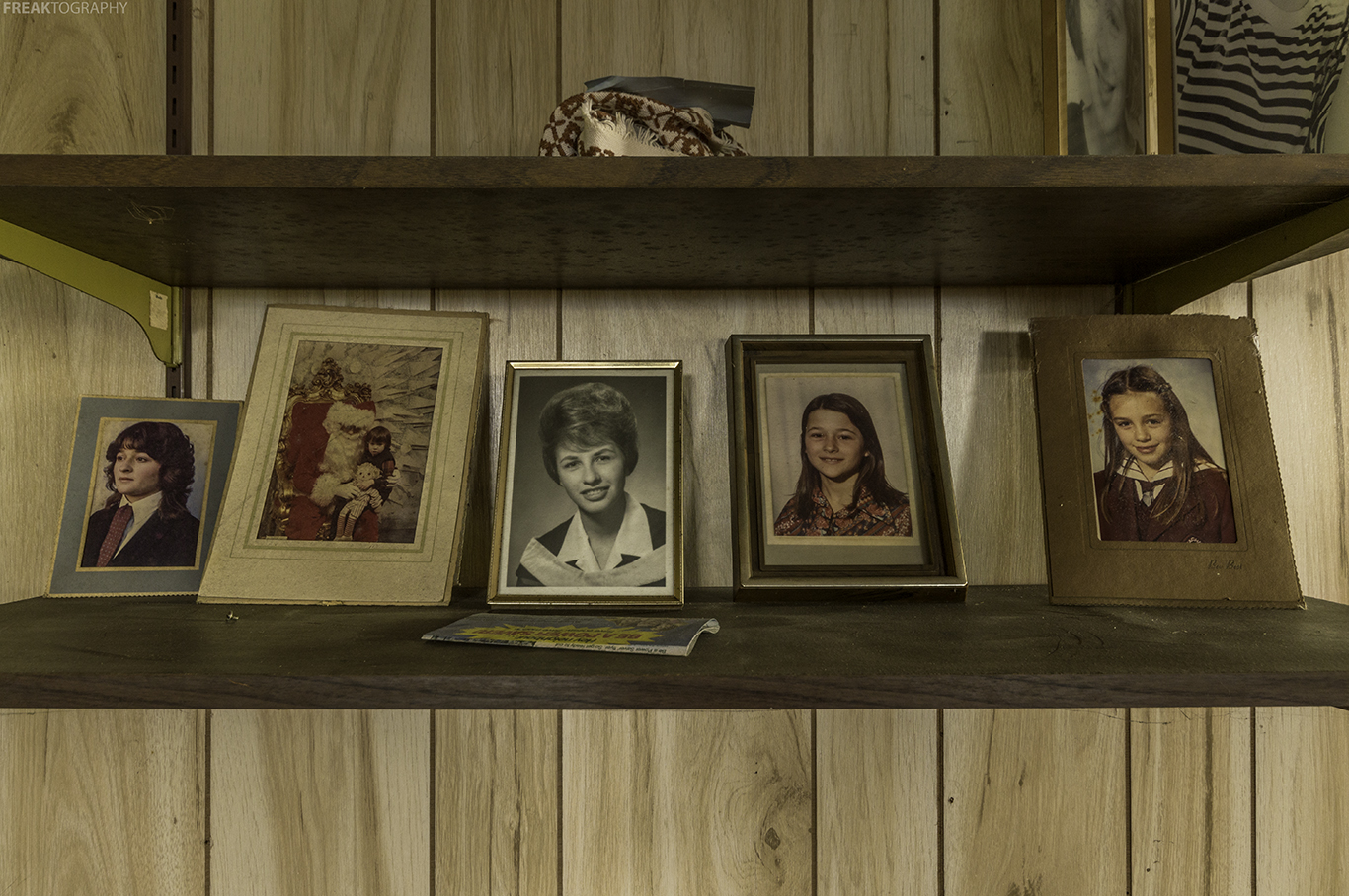 Family Photos on a shelf found inside an abandoned ontario house.