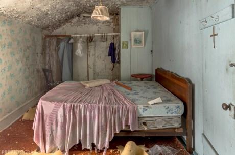 Freaktography, abandoned, abandoned house bedroom, abandoned photography, abandoned places, bed, bed in abandoned house, blue, creepy, cross, decay, derelict, haunted, haunted places, photography, pink, urban exploration, urban exploration photography, urban explorer, urban exploring