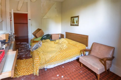abandoned 1980s hotel yellow bed sheets.