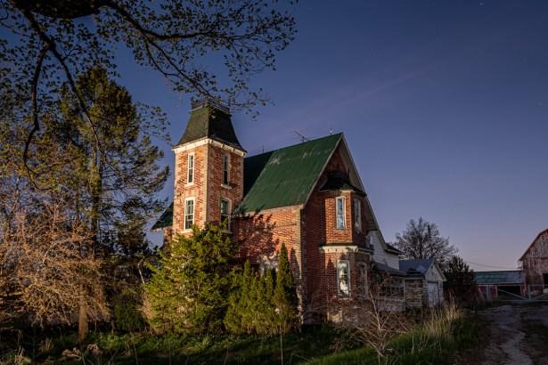 abandoned addams family farm house