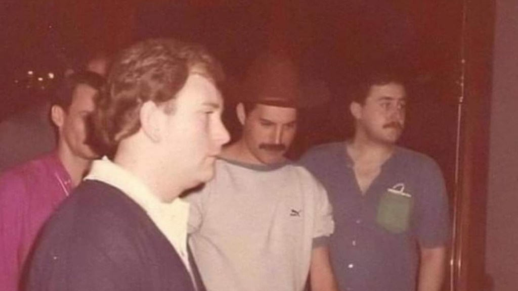 January 1985, Rio de Janeiro, Brazil, Freddie with Terry Giddings (Driver and Bodyguard) to the left and Peter Freestone to the right.