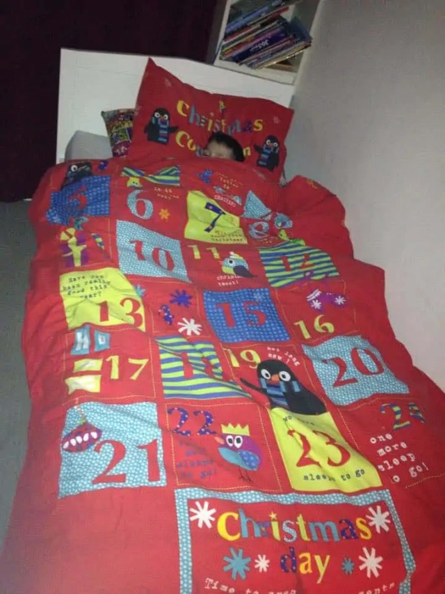 Elf Changing the Bedding to Christmas Bedding