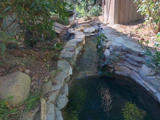 Water channel on Tom Sawyer Island that feeds the gristmill.