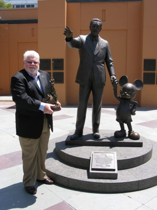 "Partners and Legends: Tom Nabbe with his Disney Legends award at the Legends Plaza at Walt Disney Studios in Burbank, California. Statues ""Partners"" and ""Legends"" by Disney sculptor, Blaine Gibson."