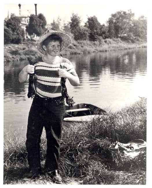 Young Tom Nabbe in 1955 catching bullfrogs on the Rivers of America at Disneyland.